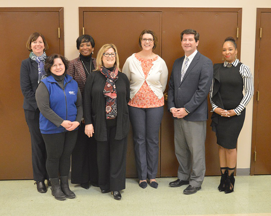 Erie County Executive Mark Poloncarz joins Karen King (fourth from left) and members of the Women's Action Coalition at the YWCA of Western New York on Grant Street in Buffalo to celebrate International Women's Day.
