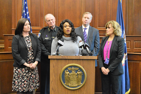 At a press conference where New York State Sen. Chris Jacobs marked Domestic Violence Awareness Month by announcing funding for key service providers, Clarissa, a survivor of abuse, shared her inspiring story. Listening to Clarissa are, from left, Crisis Services CEO Jessica Pirro, Erie County Sheriff Timothy B. Howard, Jacobs and Family Justice Center Executive Director Mary Murphy.