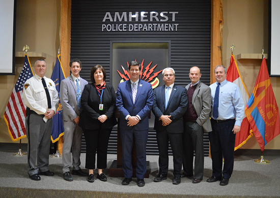 From left: Town of Amherst Police Chief John Askey, Deaf Access Services Community Engagement Specialist David Wantuck, Executive Director of Deaf Access Services Pamela Kefi, Erie County Executive Mark C. Poloncarz, Commissioner of Central Police Services James Jancewicz, Executive Director of the Erie County Office for the Disabled Frank A. Cammarata, and Niagara University First Responder Disability Awareness Project Director David Whalen at Wednesday's announcement of a new communications tool designed to improve communications between the police and the hard of hearing and deaf community during routine law enforcement traffic stops.