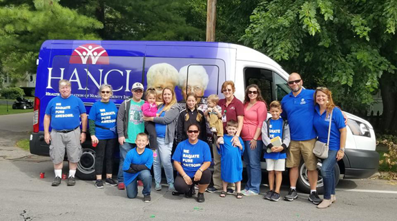 Virginia McAuliffe (far right), executive director of Complete Senior Care, along with her family, staff and participants, celebrated the nonprofit agency's seven-year anniversary with special events and activities in September, including marching in the Peach Festival Parade.
