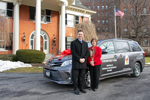 West Herr Toyota of Orchard Park General Manager Justin Rojek and Ronald McDonald House Charities of WNY Executive Director Sally Vincent pose with the new 2020 Toyota Sienna van.