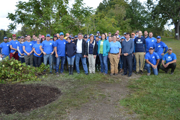 Erie County Executive Mark C. Poloncarz (front row, fourth from right) joins volunteers from Labatt USA, the Buffalo Sabres, Pegula Sports Entertainment, WNY PRISM, Buffalo Niagara Waterkeeper and Try-It Distributing at Erie County's Seneca Bluffs Natural Habitat Park on Seneca Street in Buffalo to clean up the habitat area, remove invasive species and plant indigenous pollinator plants and grasses at the site.