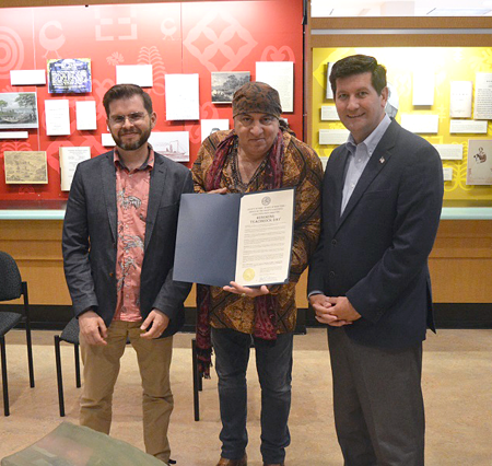 Erie County Executive Mark C. Poloncarz (right) joins Rock and Roll Hall of Famer `Little` Steve Van Zandt (center, holding proclamation) and TeachRock Executive Director Bill Carbone at the Central Library in downtown Buffalo to proclaim `TeachRock Day` in Erie County.