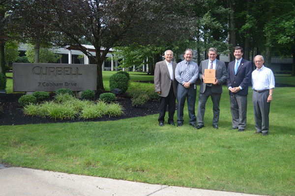 Erie County Executive Mark C. Poloncarz (second from right) is joined by USEPA Region 2 Public Affairs Specialist Mike Basile, Director of Safety and Environmental Affairs for Curbell Inc. Mark Shriver, Erie County Commissioner of Environment and Planning Thomas Hersey, and Curbell Inc. Chairman Tom Leone at Curbell's Orchard Park headquarters. Hersey and Shriver received the EPA's 2017 `Environmental Champion` award for their work on the WNY Sustainable Business Roundtable.