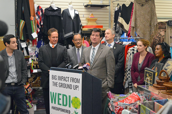 Erie County executive Mark C. Poloncarz (at podium) is joined by Congressman Brian Higgins, elected officials, members of the Westminster Economic Development Initiative Inc. (`WEDI`), and vendors from the West Side Bazaar on Grant Street in Buffalo as he announces an expansion of the Erie County Senior Services department's popular congregate dining program to include local restaurants such as the Bazaar.