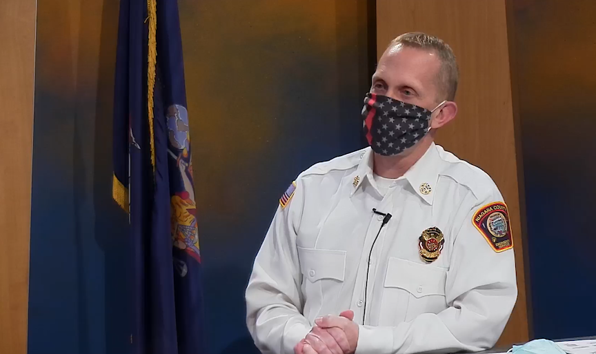 Niagara County Director of Emergency Services/Fire Coordinator Jonathan Schultz shows off the proper way to wear a cloth mask. He appeared Friday on LCTV.