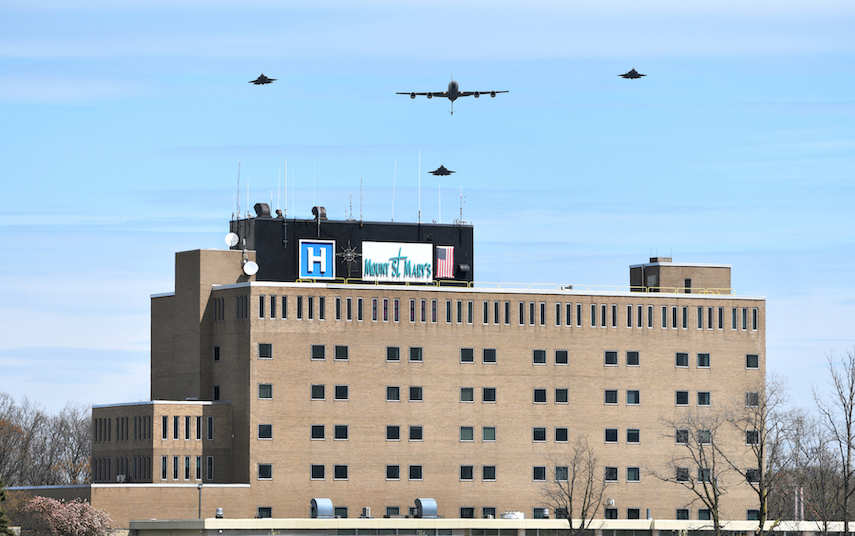 The squadron soars above Mount St. Mary's Hospital in Lewiston. (Photo by Mark Williams Jr.)