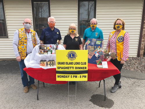 Grand Island Lions Club members are selling tickets for their 52nd annual spaghetti dinner, to be held from 5-8 p.m. Monday, April 26, as a drive-thru at the Knights of Columbus. From left: Dick Crawford, Paul Krupa, Anne Fahning, Tom Rusert and Kelly McGarvey. (Submitted photo)