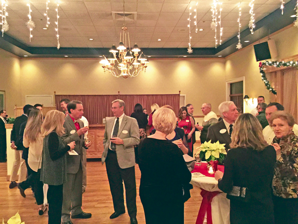Grand Island Chamber of Commerce members mingle at the annual holiday party held Dec. 14 at the Buffalo Launch Cub.