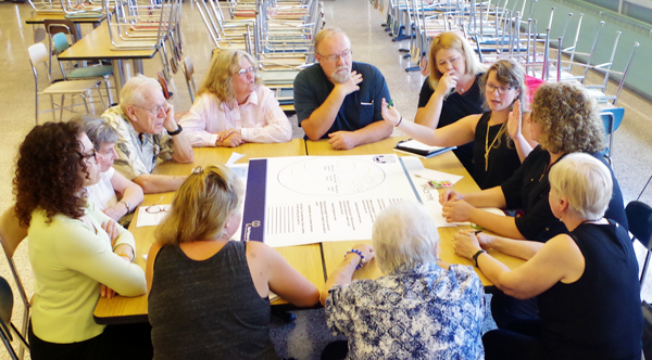 Melanie Anderson of Clark Patterson Lee, consultants for the Town of Grand Island conducting a feasibility study for a possible community center on the Island, conducts a survey at a workshop Tuesday in the Grand Island High School large cafeteria. (Photo by Larry Austin)