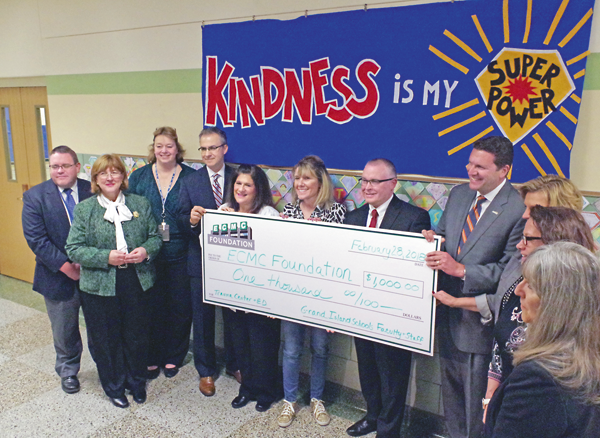 Representatives of ECMC accepted a $1,000 donation from Grand Island schools Wednesday to help fund the hospital's capital project.