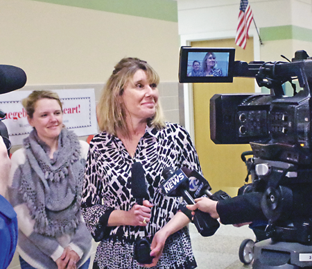 Trauma survivor Dana Papaj of Grand Island speaks to the media as her daughter, Brittany Gruttadauria, looks on. (Photo by Larry Austin)