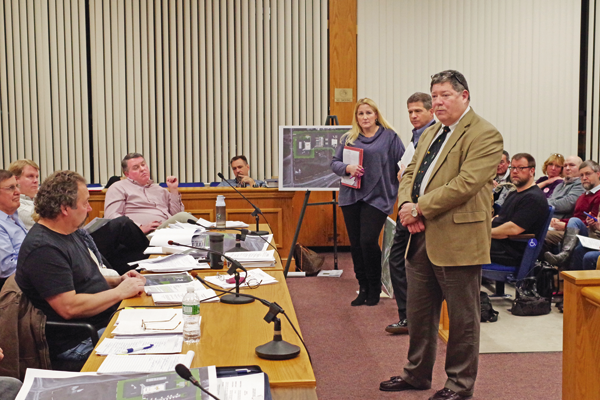 Rick Shuffield, vice president of real estate and development for Love's Travel Stops and Country Stores, speaks before the Grand Island Planning Board Monday night at Town Hall. Love's is developing a plan to build a truck stop on Whitehaven Road. (Photo by Larry Austin)
