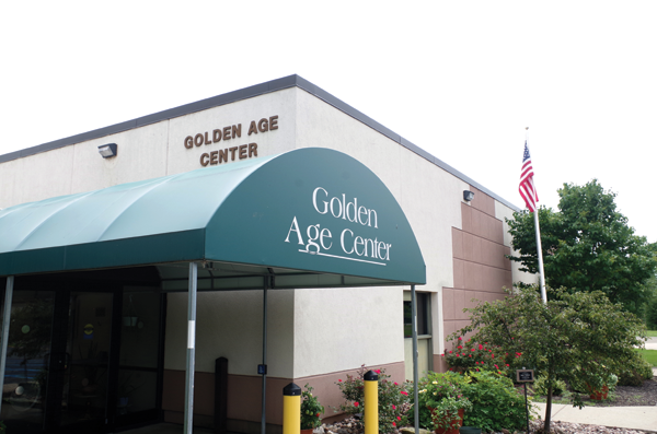 Members of the Golden Age Club discussed the future of the Golden Age Center at the Nike Base Park during a lunchtime meeting Thursday. Town Supervisor Nathan McMurray also attended the meeting, which packed the GAC dining area. (Photo by Larry Austin)