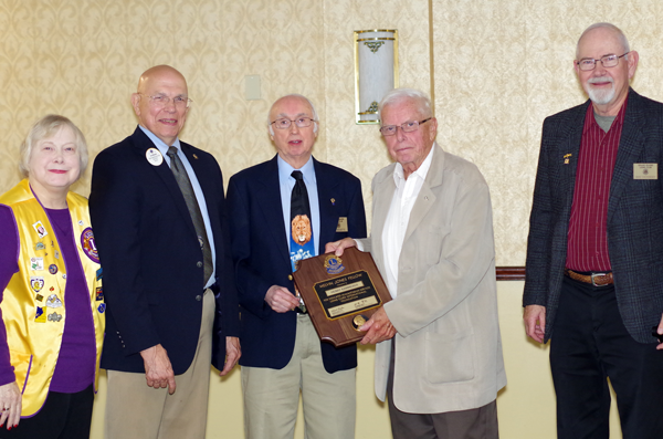 From left, Grand Island Lions Annette Bois-Lobl, Tom Witkowski, and Paul Bassette, and Dave Chervinsky (far right) present Henry Kammerer with the Melvin Jones Fellowship honoring his decades of service. (Photo by Larry Austin)