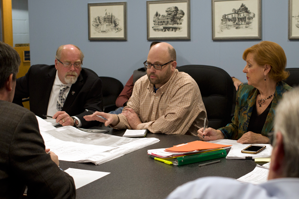 Jim Churchill, center, of Churchill Architectural, reviews diagrams with Grand Island Town Board members Monday during a work session at Town Hall. Councilmembers were reviewing plans for a pavilion in Veterans Park. (Photo by Larry Austin)