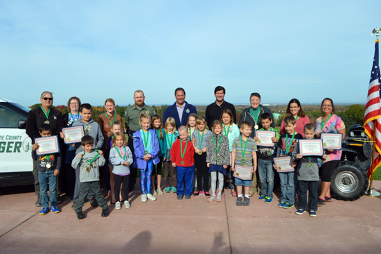 Erie County Executive Mark C. Poloncarz (back row, fourth from right) joined Parks Commissioner Dan Rizzo and Park Ranger Chuck Bartlett, along with Junior Park Rangers and their families, to celebrate the Junior Park Ranger Class of 2017 last October in a ceremony at Chestnut Ridge Park.