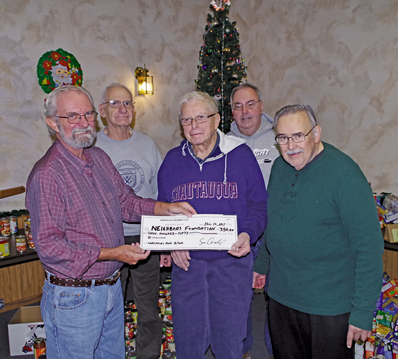 Past Grand Knight Bill Gworek presents Hank Kammerer of the Neighbors Foundation a check for $350 to help the needy this holiday. Also pictured are (front, right) Knights of Columbus chaplain the Rev. Sam Venne, and (back row, from left) Past Grand Knight Dick Dietrich and Neighbors Foundation Vice President Denny Dahl. (Photo by Larry Austin)