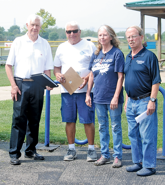 Committee members for the Father's Day Lawnmower Race met this week to plan this year's event, which has moved to Sept. 15. Pictured, from left, are committee members Skip Mazenauer, publisher of the Island Dispatch; Gary Roesch, Mary Ehde and Eric Berger. Committee members not pictured are: Floyd Doring, Lynn Dingey, Becky Stufkosky, Peter Marston, Jodi Robinson, Rod Reisdorf, Paul Proctor, Mark Leffler, Kevin Cobello, Pat Patterson, Kim Kalman, John Pullano, Jennifer Baney, Tom Long, Tom Snyder, Gary Roesch, Dan McMahon and Ray DeGlopper.