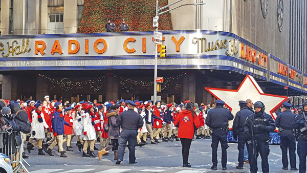 Pearl Sciolino-Coffey and the cast march past Radio City Musical Hall. (Photo courtesy Trina Coffey)
