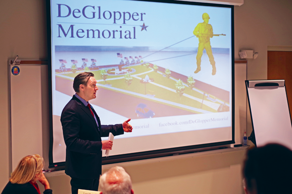 Town Supervisor Nathan McMurray speaks before the Niagara River Greenway Commission Tuesday on behalf of the DeGlopper Memorial Expansion Project. The commission voted 10-2 in determining the project was consistent with the greenway plan, making it eligible for future funding. (Photo by Larry Austin)