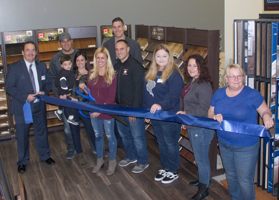 Nickel City Hardwood of Grand Island celebrated the opening of their new showroom in the Grand Island Plaza Saturday with the help of the Grand Island Chamber of Commerce. Pictured, from left: Chamber of Commerce Eric Fiebelkorn; owners: Paul and Vanessa Hinderliter and son Lucas, Carley and Mike Antonelli; in back, chamber Vice President CJ Girard; Jenn Pusatier, Toni Amantia and Sue Berger of the chamber. (Photo by Larry Austin)