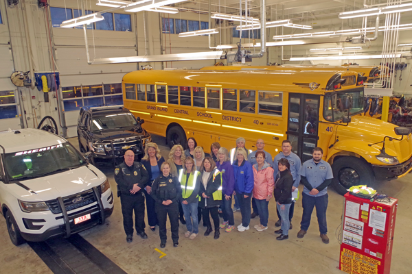 Thursday morning at 6 a.m. in the Jack Burns Transportation Center, school district bus drivers and members of law enforcement gathered to conduct Operation Safe Stop. Police vehicles followed buses to enforce traffic law during the pickup and dropoff runs. Pictured are members of the Transportation Department as well as Tom Franz of the Grand Island Police Department and Amy Klimowicz of the Erie County Sheriff's Office. (Photo by Larry Austin)