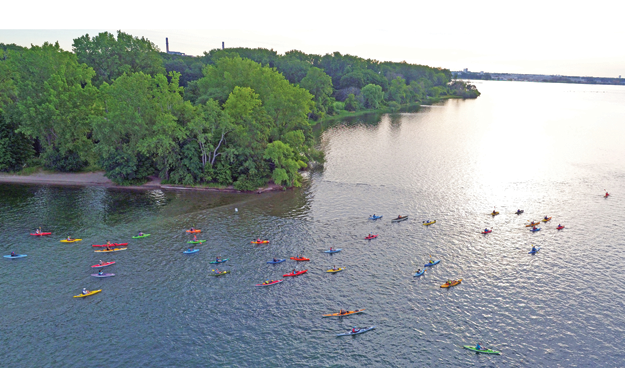 Paddles Up! participants begin to paddle from the beach at Beaver Island State Park. (Photos by K&D Action Photo and Aerial Imaging)