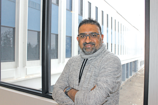Jayesh R. Patel, CEO of Rudra Management, stands at a first-floor window of his new Holiday Inn Express hotel at 2761 Long Road, at the site of the former Dunlop building. A May 17 opening is planned.