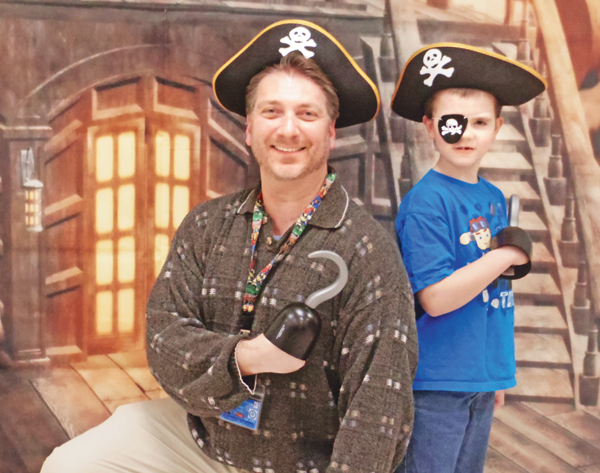 Mark Gorton and Matthew Eggers are in the pirate spirit, theme of this year's Relay For Life, as the June 9 event's honorary survivors. (Photo by Alice Gerard)