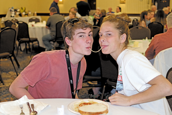 Nick Hess and Kira Hutton recreate the famous spaghetti scene from the Disney movie `Lady and the Tramp.` (Photo by Larry Austin)