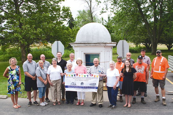 The historic cupola from the old Grand Island Town Hall was moved from Kelly's Country Store Wednesday to the new Town Hall parking lot. It will be a talking point of a celebration hosted by the town's Historic Preservation Advisory Board scheduled for Saturday, July 7, at 1 p.m. called `Grand Island Town Hall Birthday Bash!` Old Town Hall was demolished in 1968 when the new Town Hall was built, but the cupola was saved by Walt Kelly and moved to Kelly's Country Store soon after old Town Hall was removed. Pictured, front and center: Maureen Knight of Kelly's Country Store; Sharon Nichols, Shirley Luther, Carolyn Doebert, Joe Macaluso and June License of the Historic Preservation Advisory Board; and Councilwoman Jennifer Baney. Back row, left: Town Historian Jodi Robinson, Kevin Kelly and Sean Kelly of Kelly's Country Store, Town Supervisor Nathan McMurray and Deputy Town Supervisor Jim Sharpe. Back row, right: Dave Amato of the Town of Grand Island Highway Department, Councilman Pete Marston, Mike Carlson of the Highway Department, Councilman Mike Madigan, and Jeff Korzen of the Highway Department. (Photo by Larry Austin)