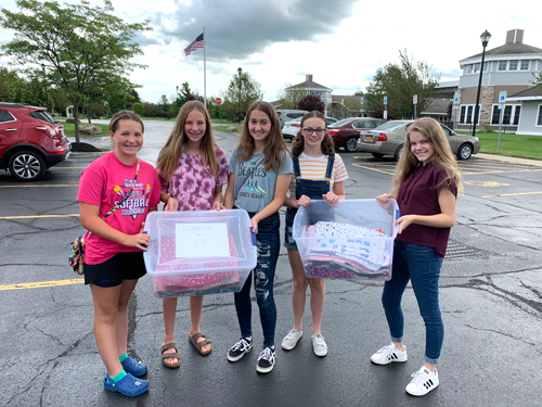 Pictured are Island Girls Scouts at Bristol Village in Clarence, where they delivered blankets for residents in the memory care program. From left: Lauren Coombs, Megan Reynolds, Berin Celik, Abbie Bentley and Wynonna Roberts.