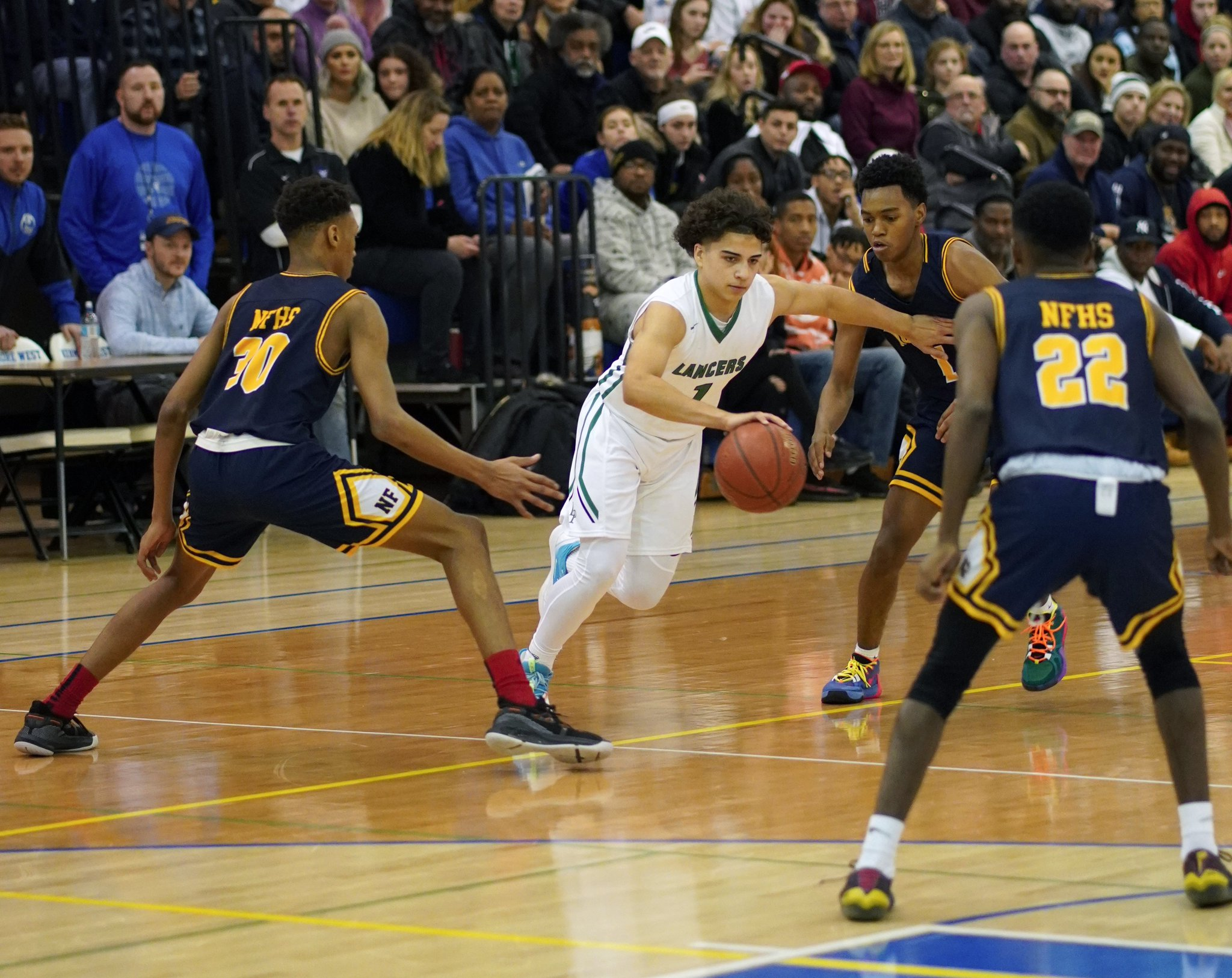 Lewiston-Porter Lancers point guard drives through defenders of Niagara Falls during last week's Niagara Frontier League title game. Duff scored 14 points in the loss. (Photo by Larry Austin)