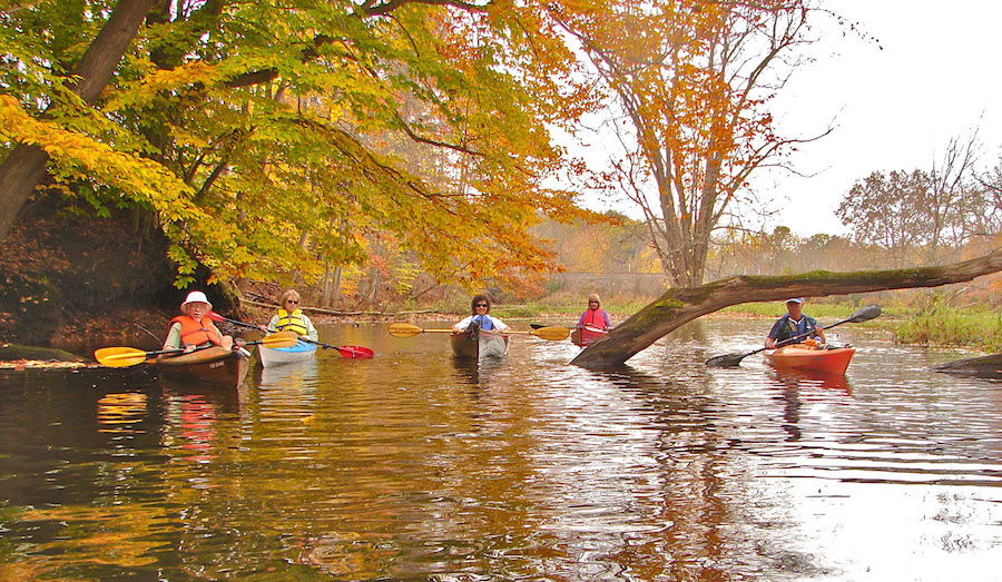 Paddlers wearing life vests enjoy fall colors. (Photo courtesy of Richard Drosse)