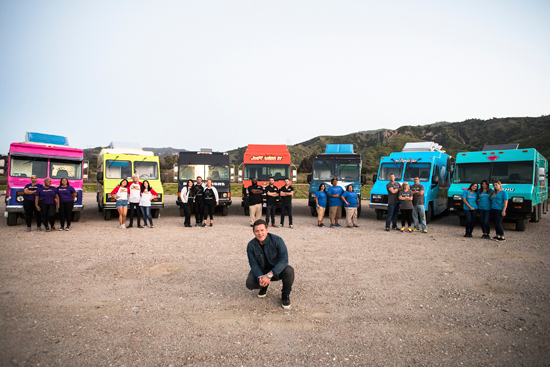 Host Tyler Florence with the teams on Food Network's `The Great Food Truck Race.` (Food Network photo)
