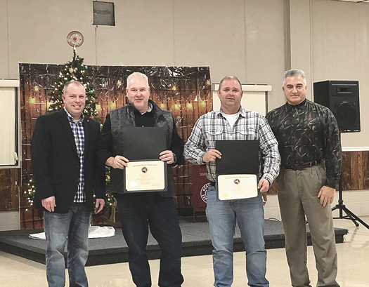 Lewiston Police Department officers Jim Ullery and Officer Scott Stafford were presented with certificates for their 20 years of service with the department. Joining them are Chief Frank Previte (right) and Capt. Joshua Cain.