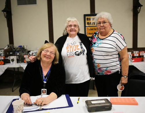 Niagara Hospice volunteers Marilyn Zaciewski (left), Peg Stevenson (middle) and Pat Longstreet sell basket raffle tickets at last year's `Cocktails & CA$H.` This year's event is Oct. 11 at the Cornell Cooperative Extension.