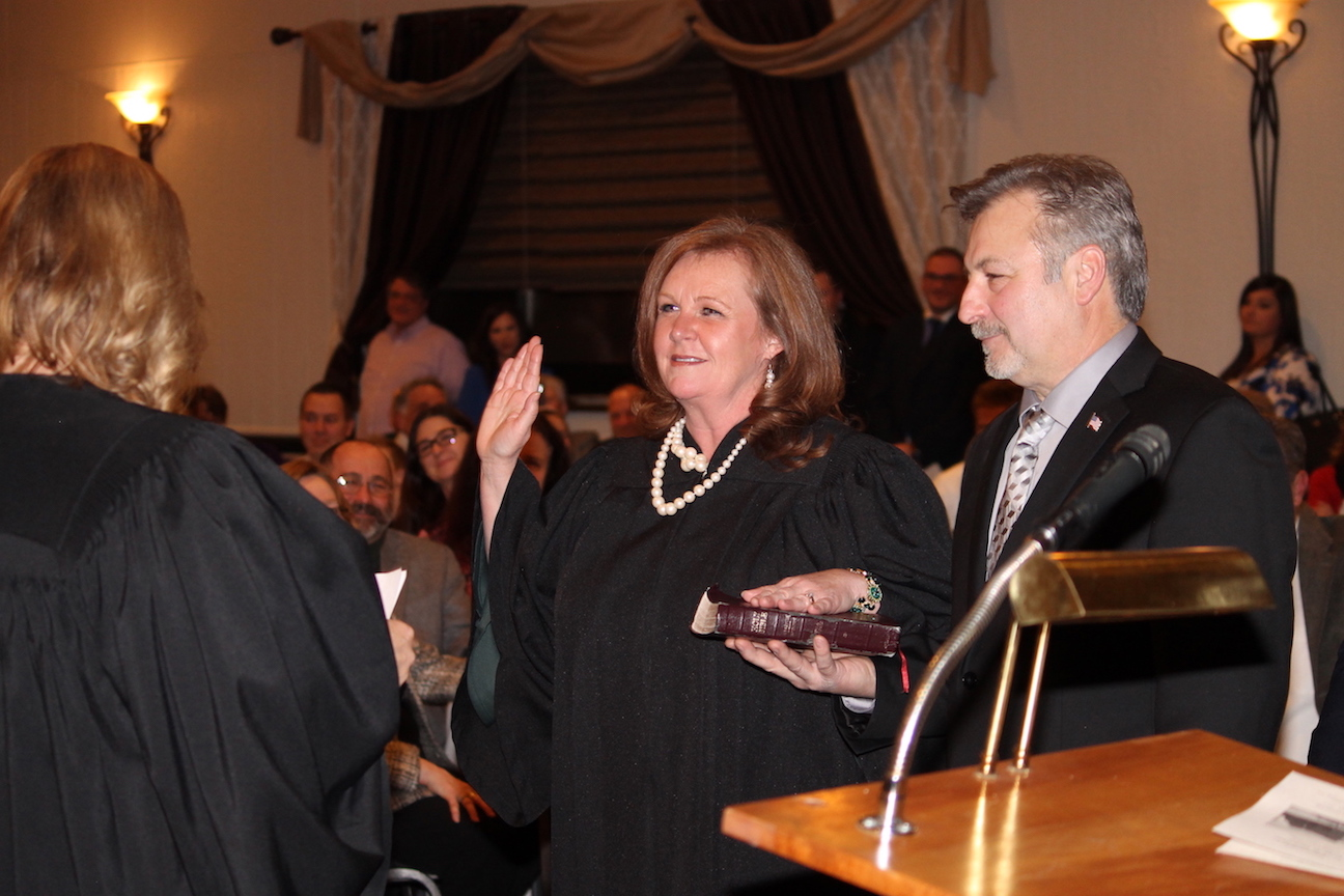 Niagara County Family Court Judge Erin DeLabio takes her oath of office from Niagara County Family Court Judge Kathleen Wojtaszek Gariano as her husband, Joey, holds the Bible. DeLabio succeeds Hon. John Batt presiding over Family Court at the Niagara County Courthouse in Lockport.
