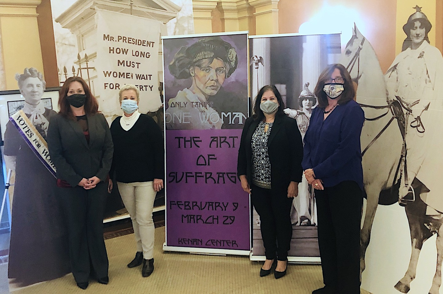 Pictured with the suffrage exhibit, from left: Niagara County Legislature Chairwoman Becky Wydysh, Legislator Irene Myers, Legislator Anita Mullane and Mary Brennan-Taylor.
