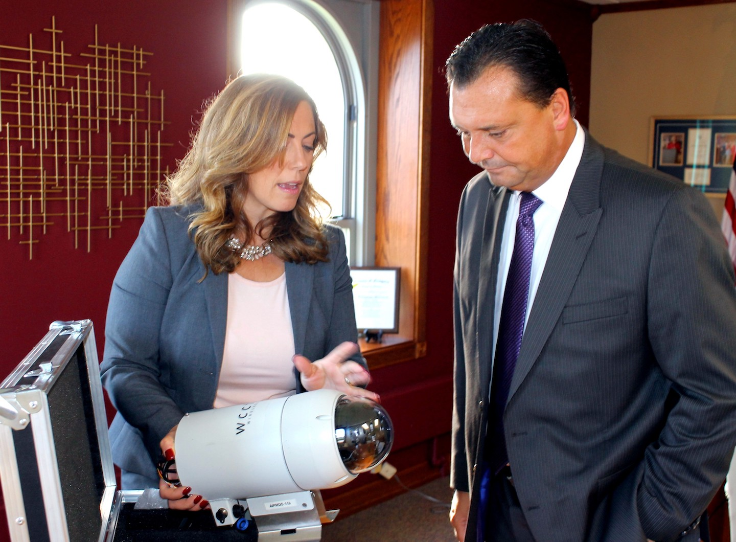 Niagara County District Attorney Caroline A. Wojtaszek explains the operation of a security camera that is set to be installed in North Tonawanda to Niagara County Legislature Majority Leader Randy R. Bradt, following an early Tuesday meeting.