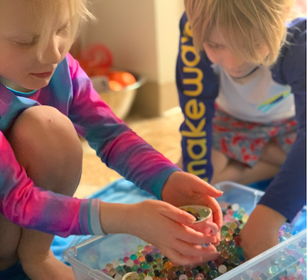 Water beads, as shown in the picture, are a great tool for sensory learning and stress relief.