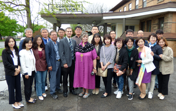 Community Missions Executive Director Robyn L. Krueger and Director of Communication Christian Hoffman joined with a group of officials from the Republic of Korea.