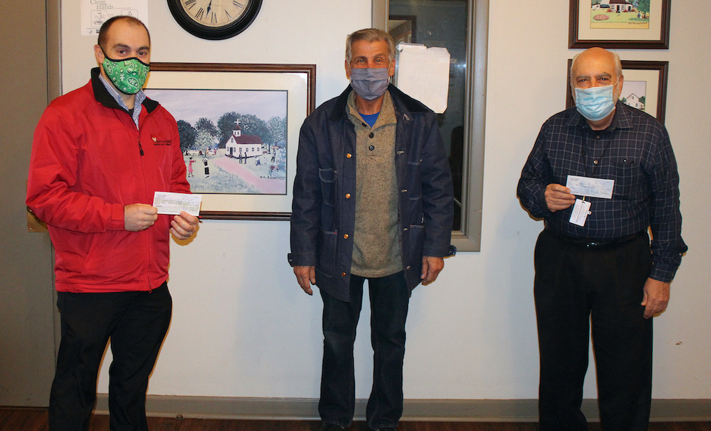 Pictured, from left: Heart, Love and Soul Food Pantry and Dining Room Executive Director Mark Baetzhold, Deposits 4 Food founder Angelo Sarkees and Community Missions Associate Director Joe Sbarbati.