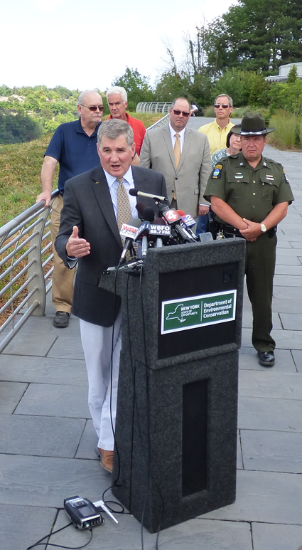 New York State Department of Environmental Conservation Executive Deputy Commissioner Kenneth Lynch addresses the media Wednesday outside the Niagara Discovery Center.