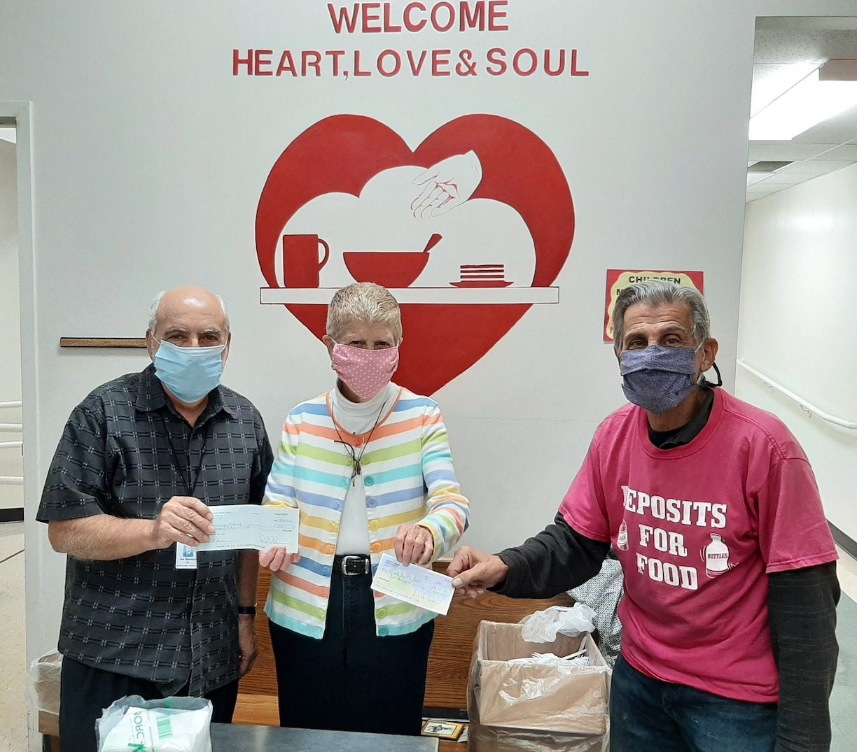 From left: Joe Sbarbati, associate director at Community Missions; Sister Beth Brosmer, former executive director at Heart, Love & Soul Food Pantry and Dining Room; and Angelo Sarkees, Deposits 4 Food founder.