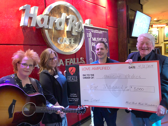 Pictured, from left, are Musician Medics volunteer `Rockin` Robin Grandin, Hard Rock Sales and Marketing Manager Cara Turner, Buffalo Music Hall of Fame President Anthony Casuccio and BMHOF inductee and Musician Medics Program Manager Richard Sargent.