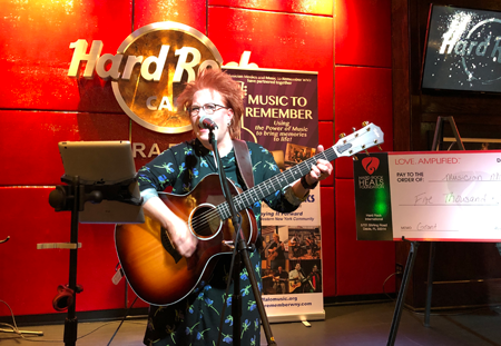 Buffalo Music Hall of Fame inductee 'Rockin' Robin Grandin performs at a press conference for Musician Medics. (File photo)