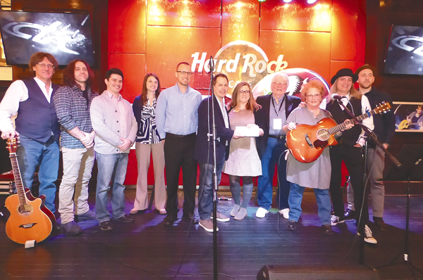 Hard Rock staffers joined with members of the Buffalo Music Hall of Fame and Veterans One-stop Center of WNY at a check presentation on Thursday.