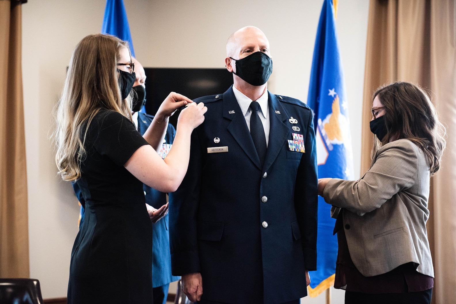 New York Air National Guard Col. Steven M. Hefferon has his new rank pinned on by his daughter, Jessica, and wife, Tobi, during ceremonies at Niagara Falls Air National Guard Base on Saturday. ( U.S. Air National Guard photo courtesy 107th Attack Wing)